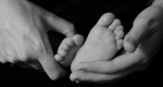 baby feet moomy hands